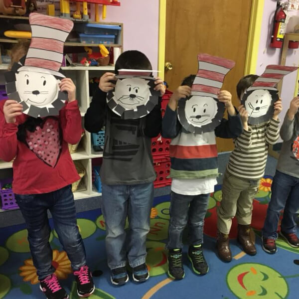 Kids Showing Off Their Cat In The Hat Masks